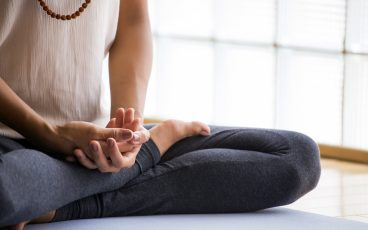 A person meditating to reduce anxiety